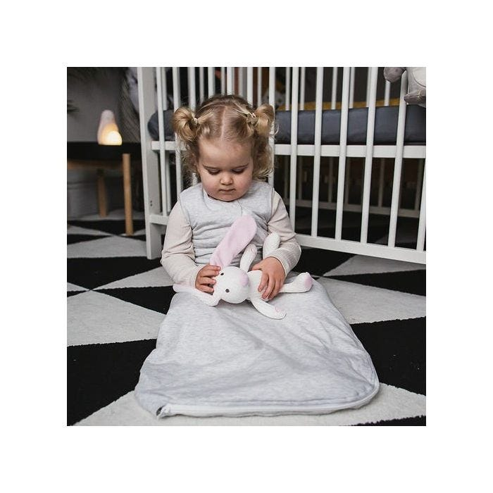 Girl playing whilst wearing grey marl sleepbag