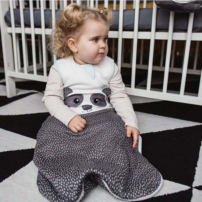 Girl with Blonde Curly Hair wearing The Original Grobag Pip the Panda Sleepbag