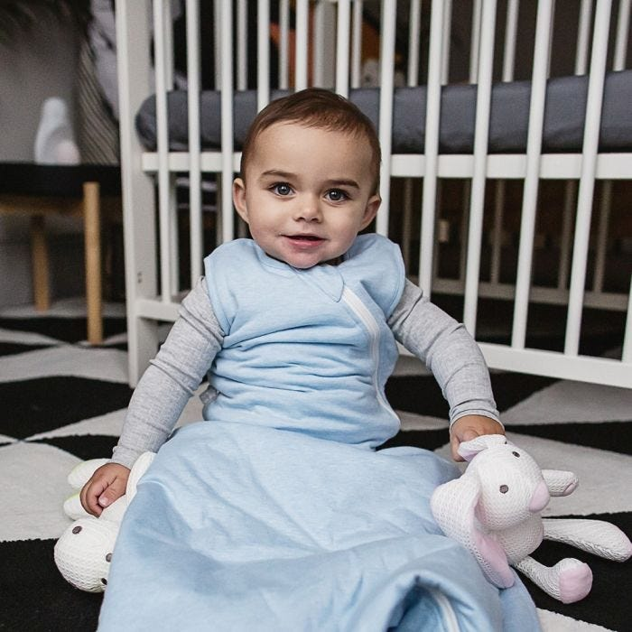 Baby wearing The Original Grobag Blue Marl Sleepbag