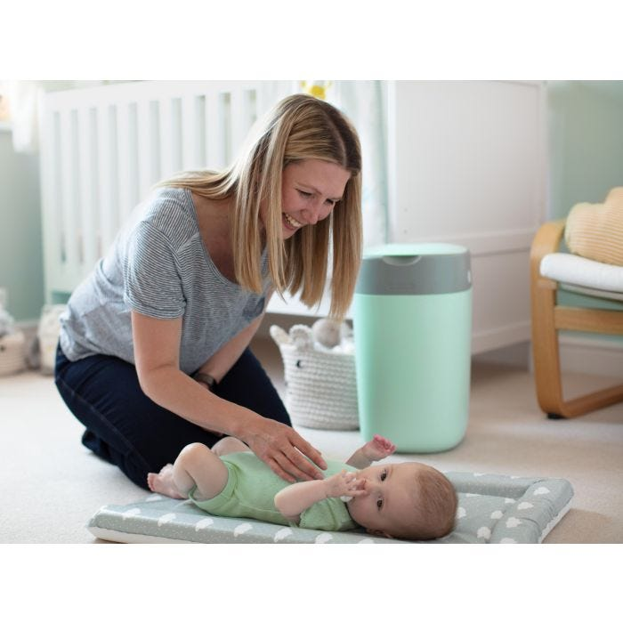 Baby being changed with Twist & Click bin in the background