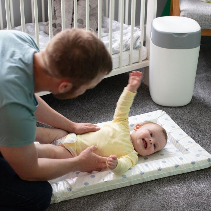 Father play with baby and  Twist & Click nappy bin