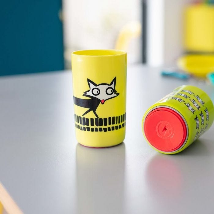 large-and-small-yellow-no-knock-cups-with-fox-design-on-kitchen-worktop-showing-base