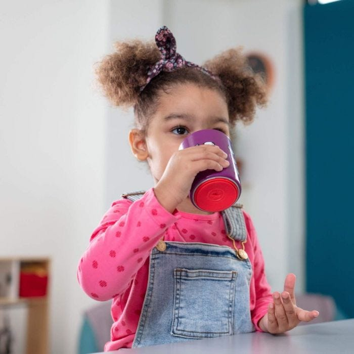 Girl drinking from a No Knock cup