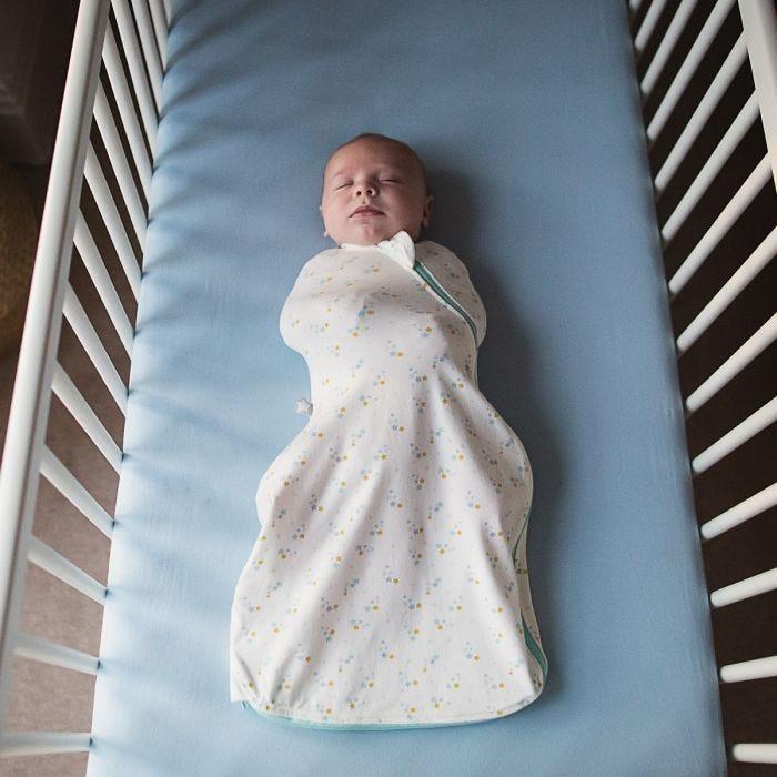 Baby sleeping in The Original Grobag Baby Stars Easy Swaddle