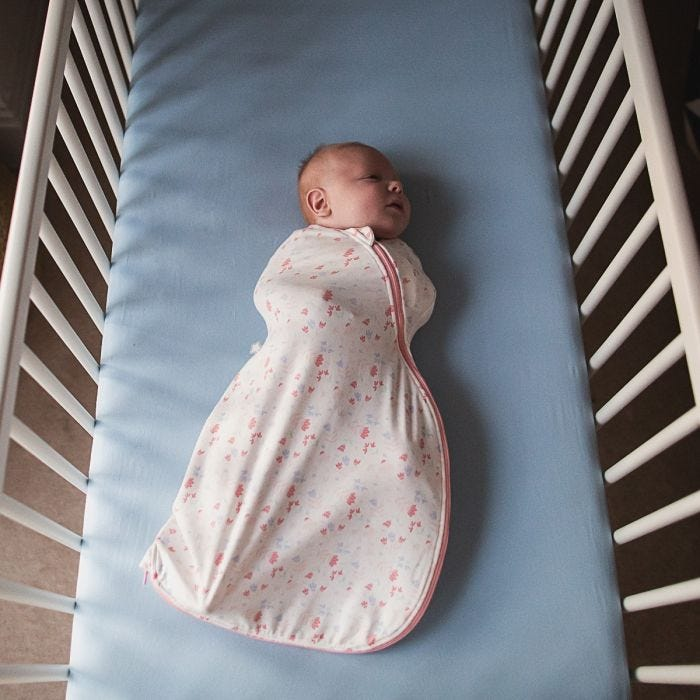 Baby sleeping in Pretty Petals Easy Swaddle