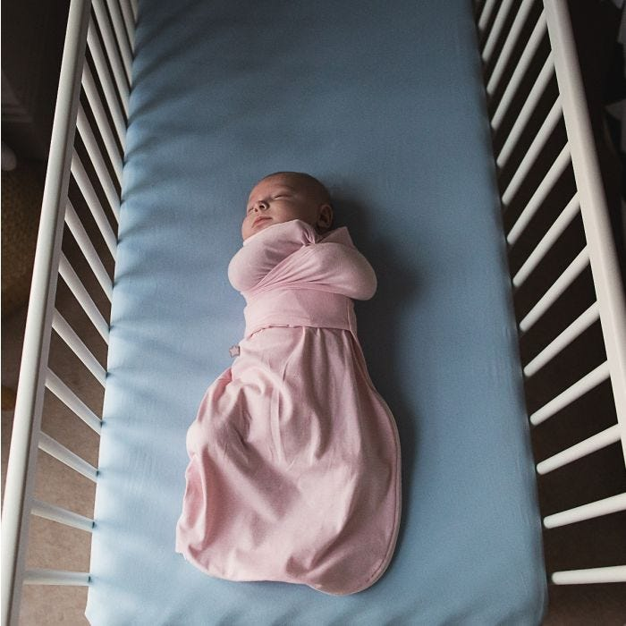 Baby sleeping in Pink Marl Swaddle Wrap