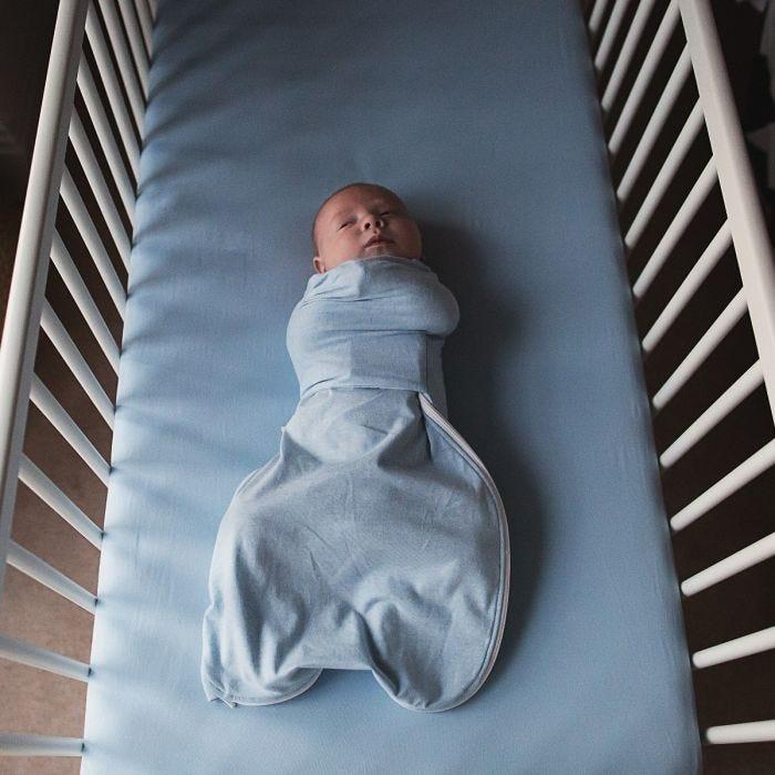 Baby wearing Blue Marl Swaddle Wrap