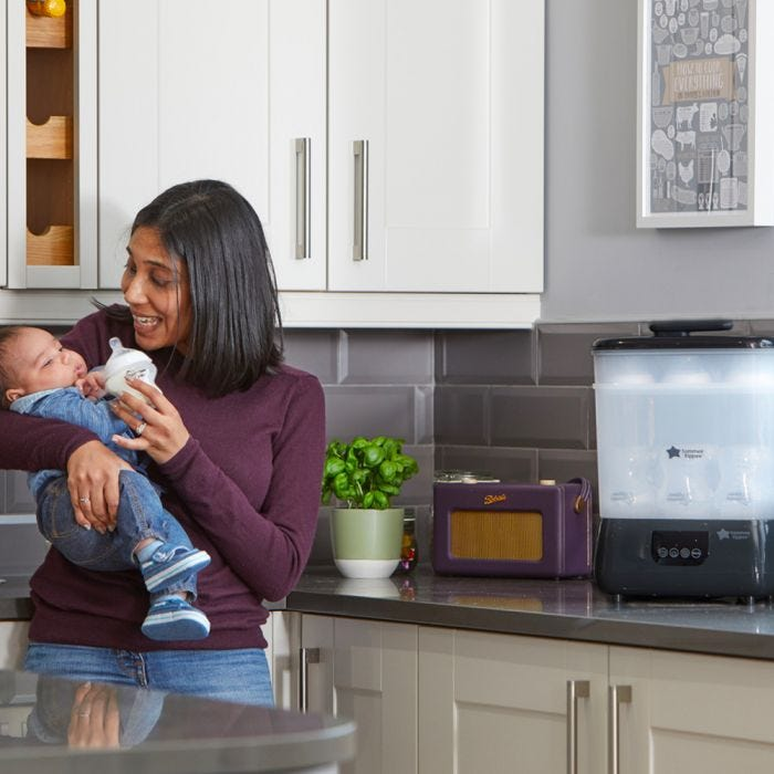 mum feeding baby with advanced steri-dryer in the background
