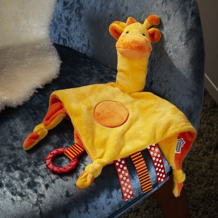 Gerry Giraffe 3 in 1 Lovey on a chair