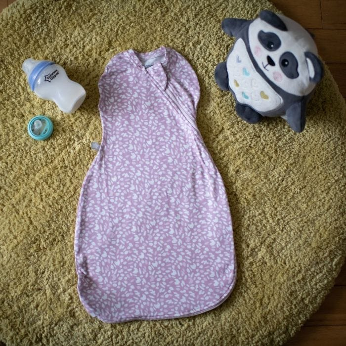 The Original Grobag Earth Grape Easy Swaddle overhead shot with grofreind and closer to nature bottle
