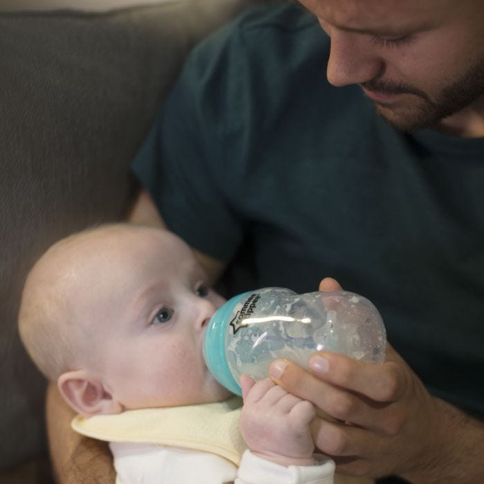 Dad feeding newborn with advanced anti-colic bottle and teat