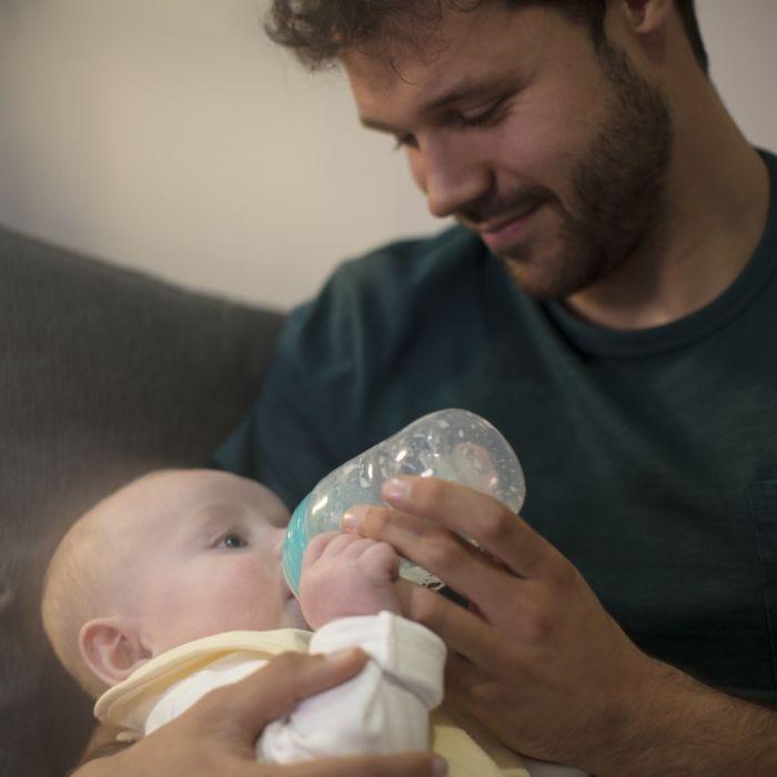 dad feeding baby with advanced anti-colic bottle