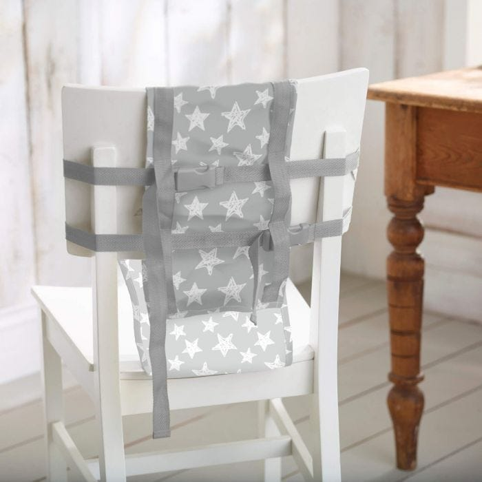 lifestyle image showing travel chair harness on kitchen chair