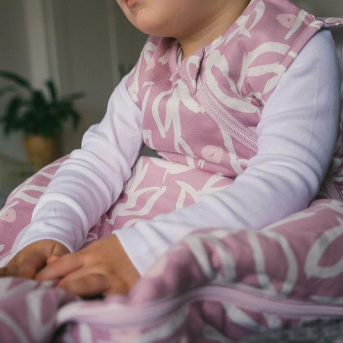 Baby wearing The Original Grobag Botanical Sleepbag