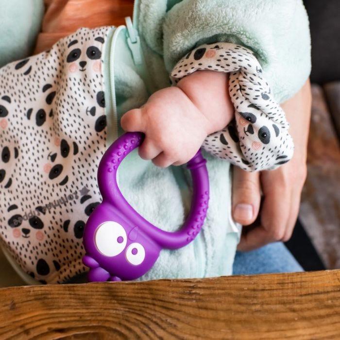 baby holding Tommee Tippee Kalani Mini Sensory Teething Toy
