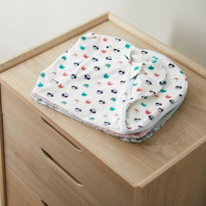 Tommee Tippee Cat and Mouse Easy Swaddle on chest of drawers