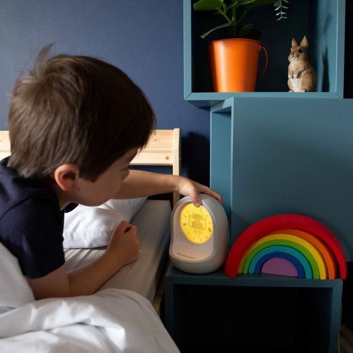 child holding tommee tippee sleep trainer