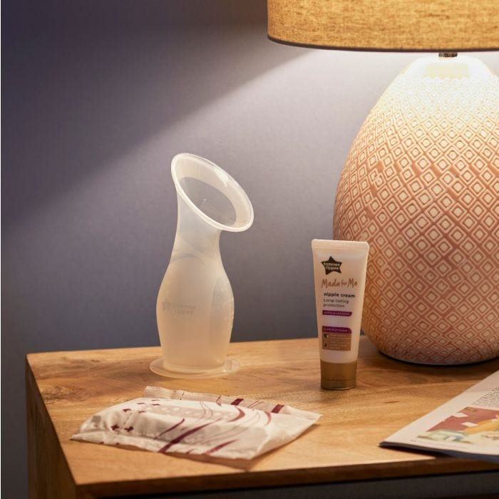 Made for Me Silicone Breast Pump and nipple cream on bedside table