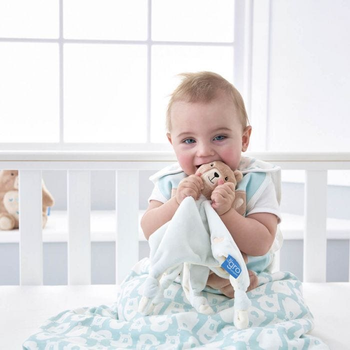 baby-in-cot-chewing-bennie-the-bear-comforter
