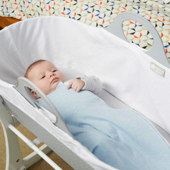 Baby in cot wearing grobag
