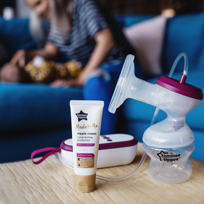 Made for me electric breast pump and nipple cream whilst mum is playing in the background with baby