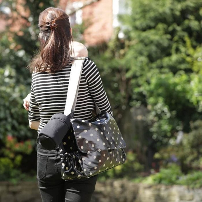 mum-carrying-insulated-bottle-bag-attached-to-changing-bag