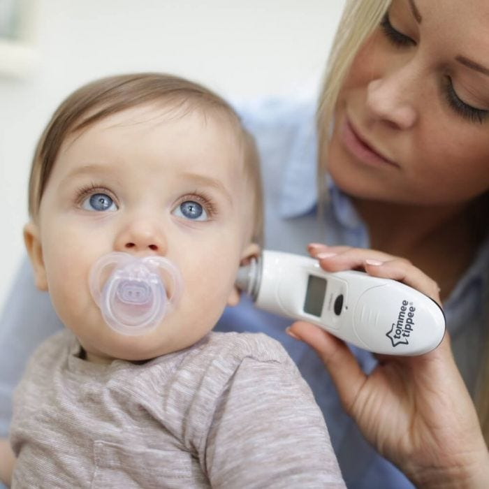 mother-taking-babys-temperature-using-digital-ear-thermometer