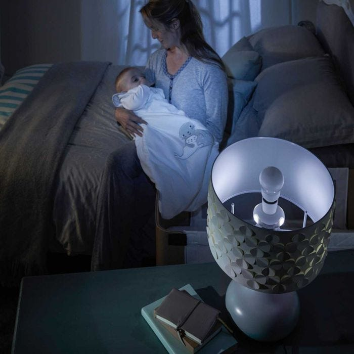 Grolight in the bed side lamp with mother holding child in Grobag
