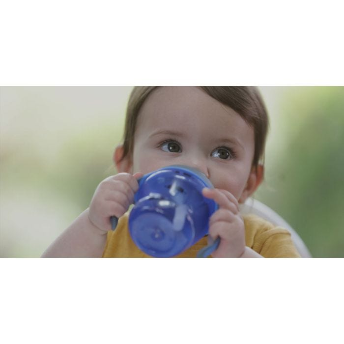 Baby drinking from blue Tommee Tippee First Straw Cup