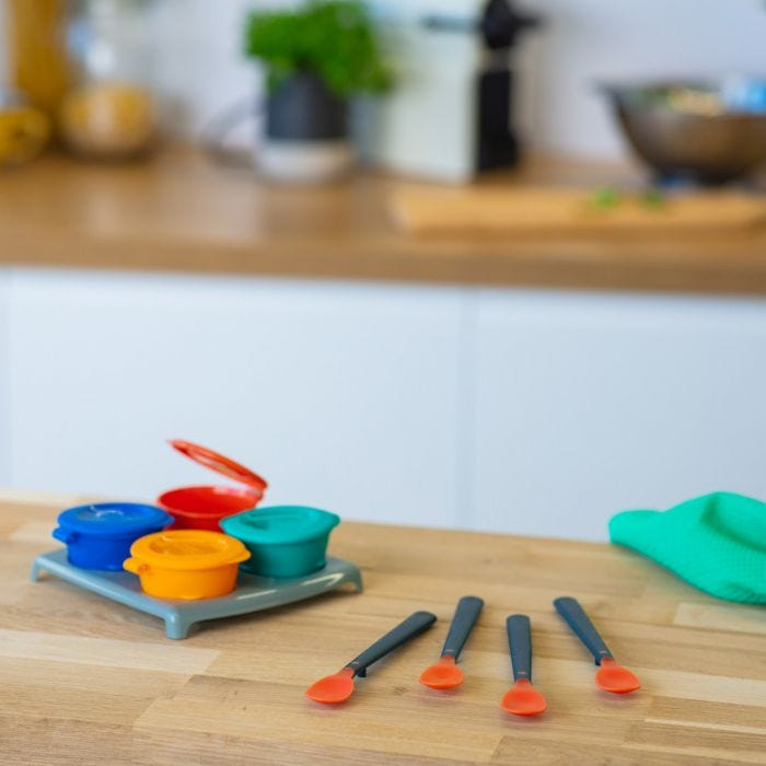 heat sensing spoons and storage pots on kitchen table