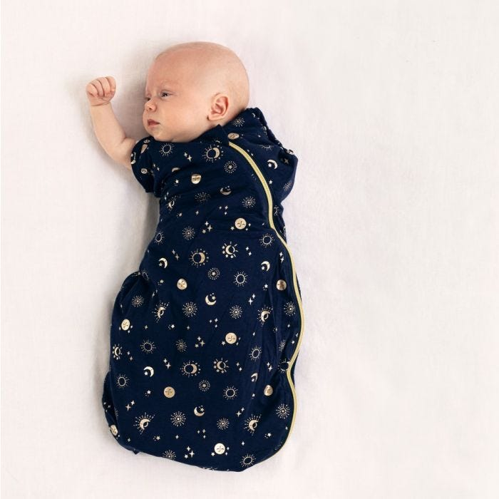 baby wearing tommee tippee moon child snuggle with arm raised