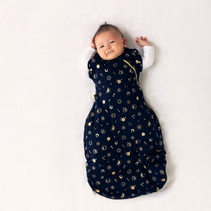 baby wearing tommee tippee moon child snuggle with both arms raised
