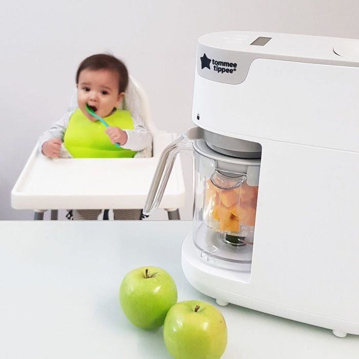 Steamer Baby Food Maker and child waiting for food