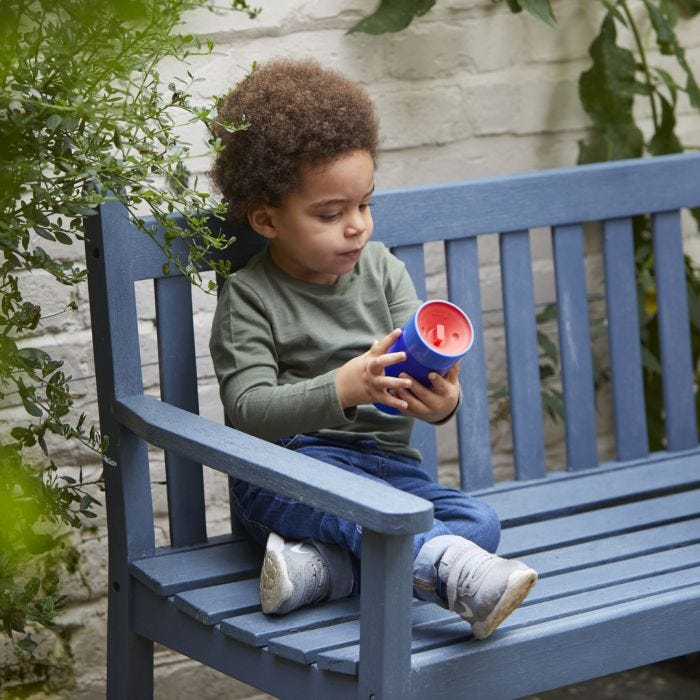 boy holding Insulated 360 cup blue
