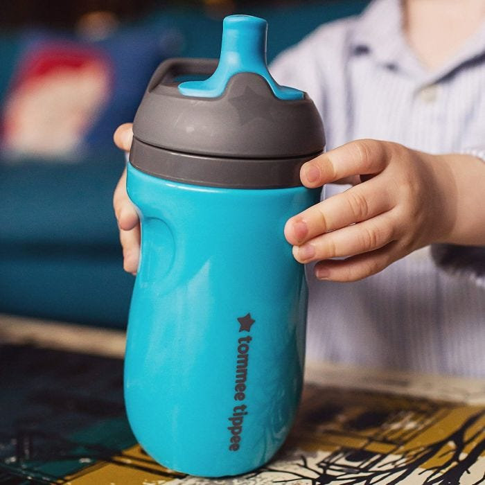 Child holding insluated sippee bottle