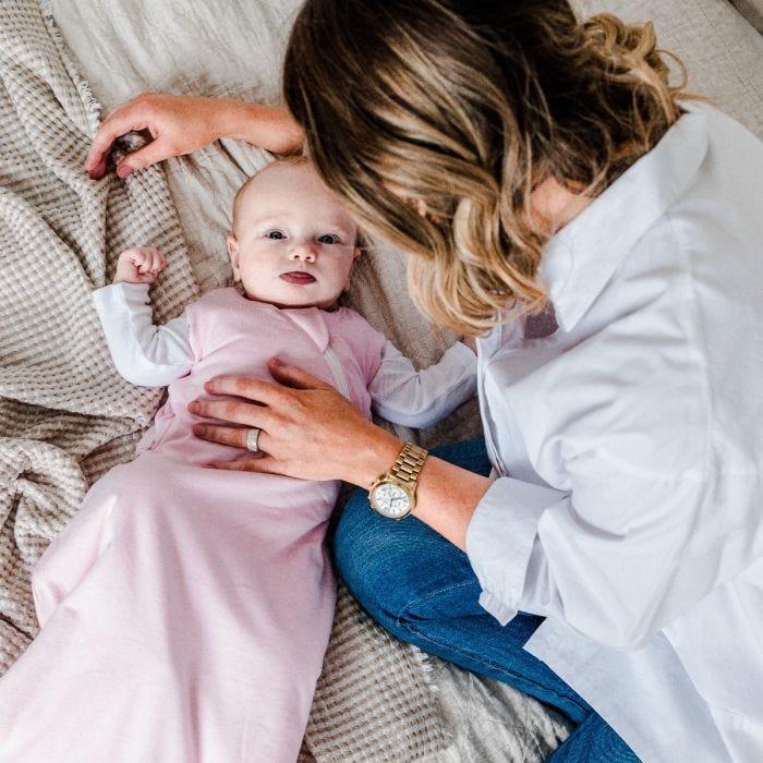 Child wearing Pink Marl Sleepbag