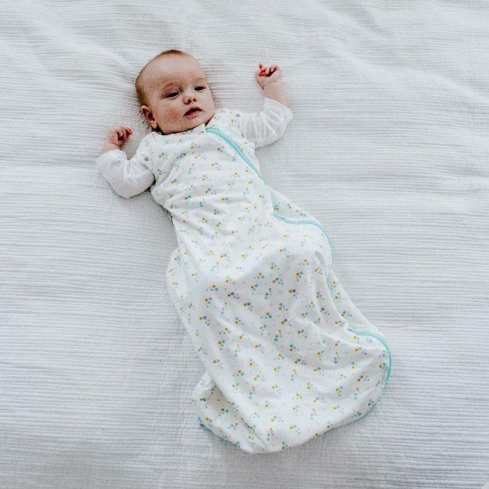 Baby wearing The Original Grobag Baby Stars Snuggle