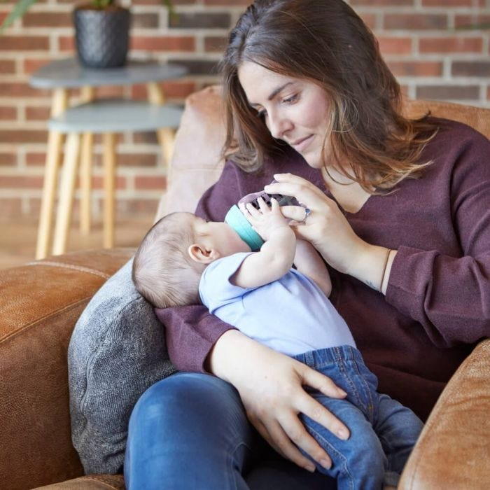 mum feeding baby with AAC bottle