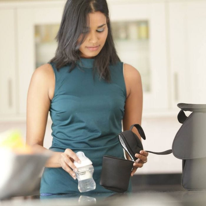 woman-inserting-bottle-into-insulated-bottle-bag