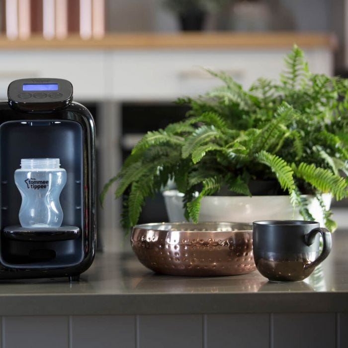 black-perfect-prep-day-and-night-machine-on-kitchen-bench-next-to-plant