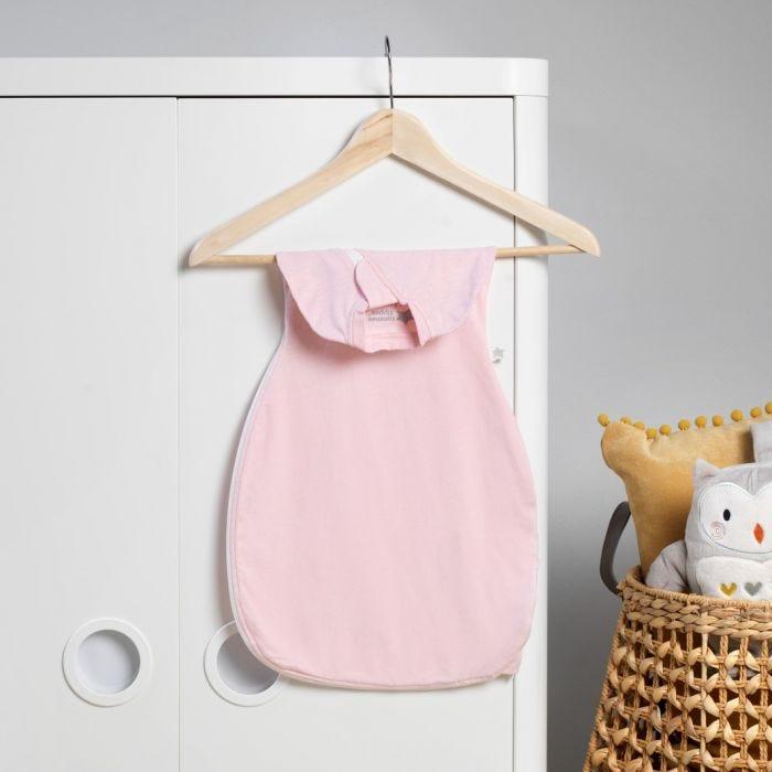 pink marl easy swaddle hanging on wardrobe