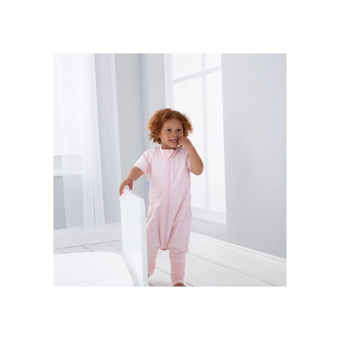 child playing wearing GroRomper - Scandi Harvest Pink