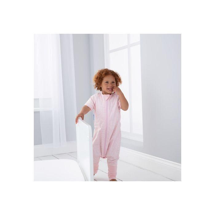 child playing wearing GroRomper - Scandi Harvest Pink