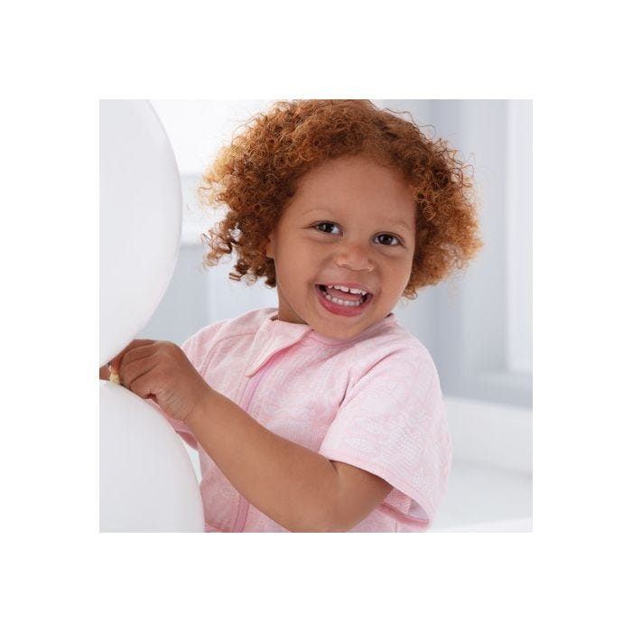 child playing wearing GroRomper