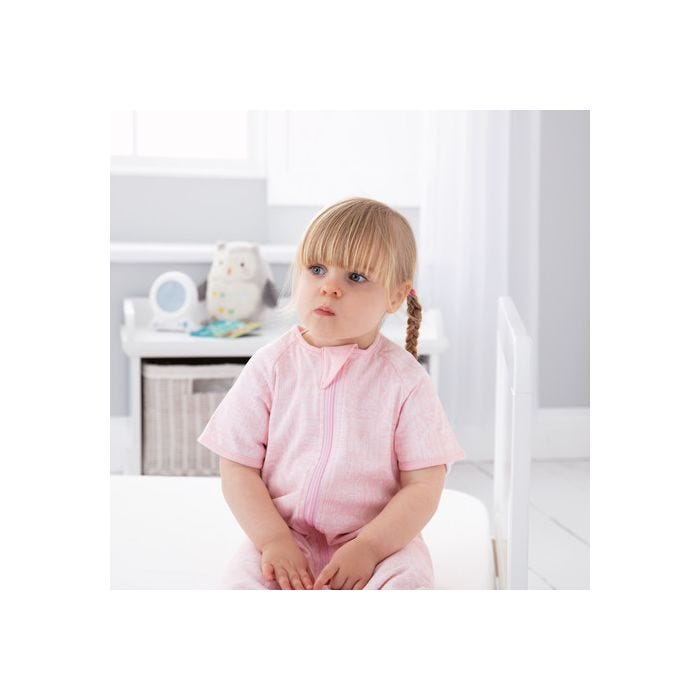 child wearing GroRomper - Scandi Harvest Pink