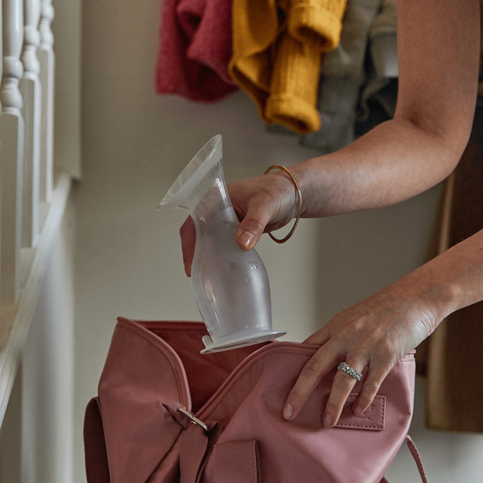 mum placing silicone breast pump into handbag