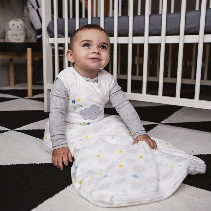 Sleepy Sky Sleepbag - baby sitting on nursery floor