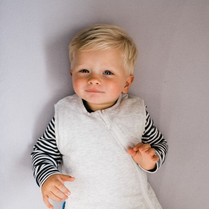 Boy wearing The Original Grobag Grey Marl Sleepbag
