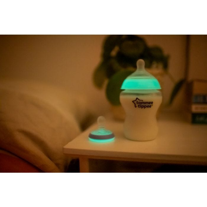 Closer to Nature Glow Bottle and Breast Like Soother Night Time on bedside table