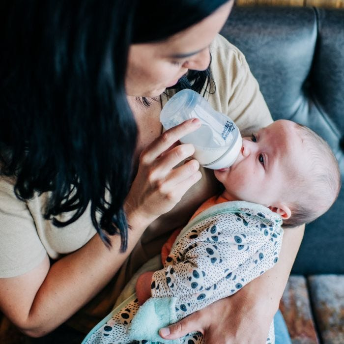 Mum feeding with Closer to Nature Baby Bottle